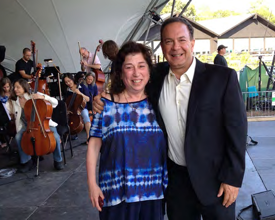 ICSOM President Brian Rood (right) poses with Grand Rapids Symphony violinist Sunny Girlin following a rehearsal on July 30 at Cannonsburg, Michigan, the summer home of the Grand Rapids Symphony.Photo credit: Paul Austin