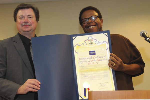ICSOM Chair Bruce Ridge and LA Philharmonic delegate John Lofton, holding the proclamation by the LA County Board of SupervisorsPhoto credit: Leslie Shank