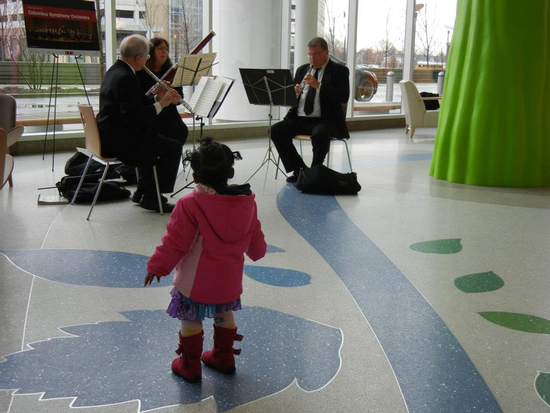 Randall Hester, flute, Robert Royse, oboe, and Betsy Sturdevant, bassoon, performing at Nationwide Children's Hospital Photo credit: Linda Oper