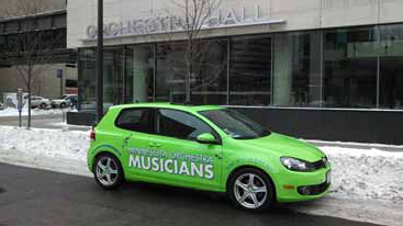 Minnesota flutist Adam Kuenzel's MoMOmobile is appropriately parked outside of Orchestra Hall during the lockout. MoMO is the acronym of the Musicians of the Minnesota Orchestra. Adam used the color scheme used in MoMO lawn signs, T-shirts, and buttons. Will an Osmomobile follow?Photo credit: Adam Kuenzel